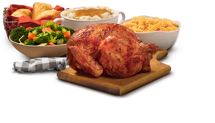 Rotisserie Chicken with three sides and cornbread loaves