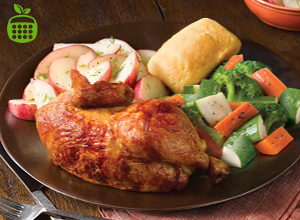 Rotisserie Half Chicken with Oven Baked Potatoes and a Side of Vegetables.