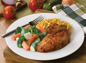 Rotisserie Half Chicken with a Side of Vegetables and Corn.
